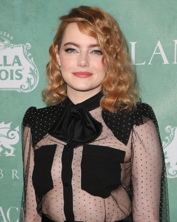Emma Stone in a sheer tulle bow accented blouse