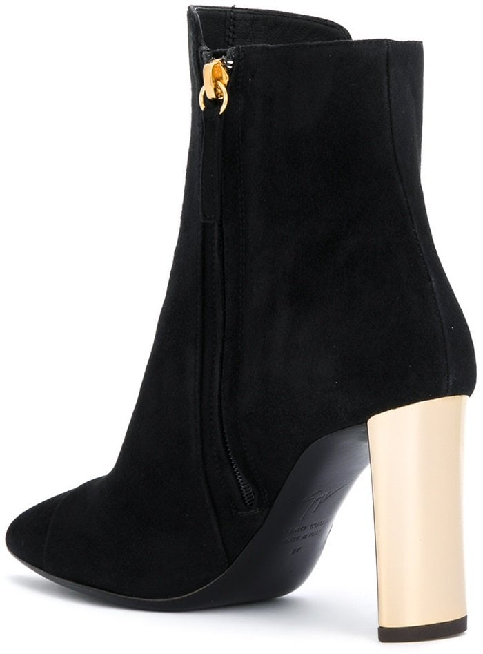 These boots feature a round toe, a main internal compartment, a side zip closure, a leather sole and a high gold-tone structural heel