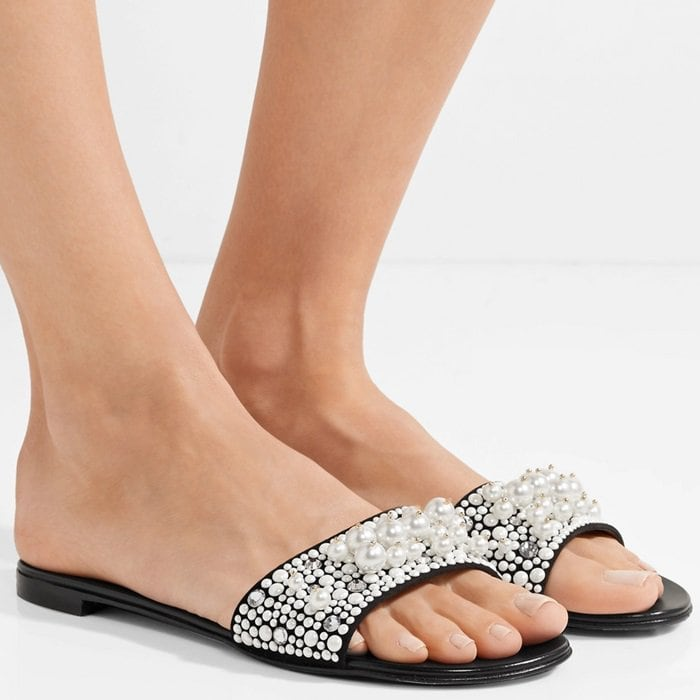 Though slides are typically casual by nature, this pair is decorated with scores of faux pearls and crystals