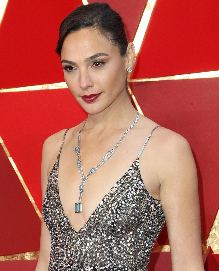 Gal Gadot wearing a silver and blue diamond statement Tiffany & Co. necklace
