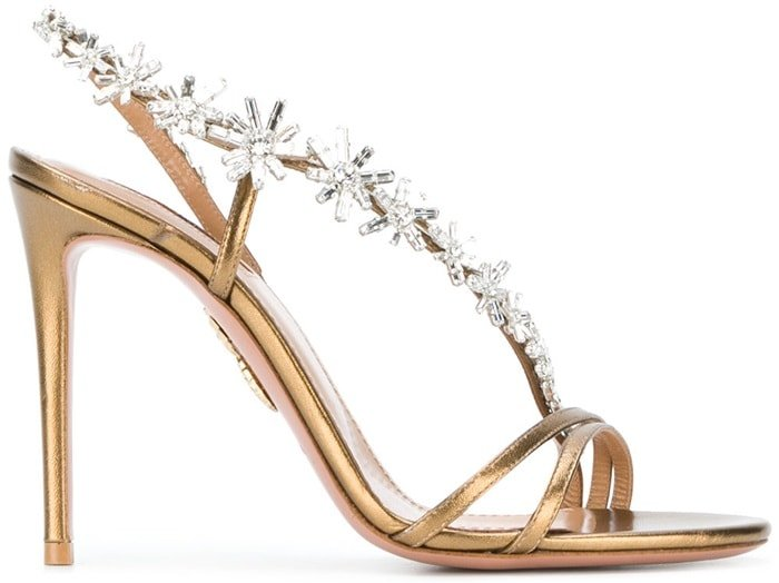 Luxury Italian footwear brand Aquazzura is famed for its exquisite and glamorous designs, as showcased by these stunning gold-tone Chateau 105 sandals
