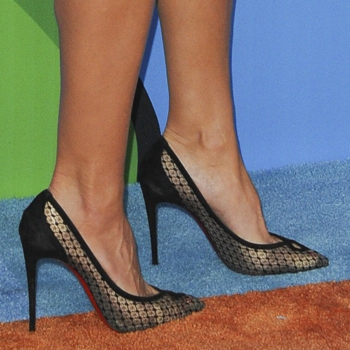 Heidi Klum's feet in red sole Christian Louboutin pumps