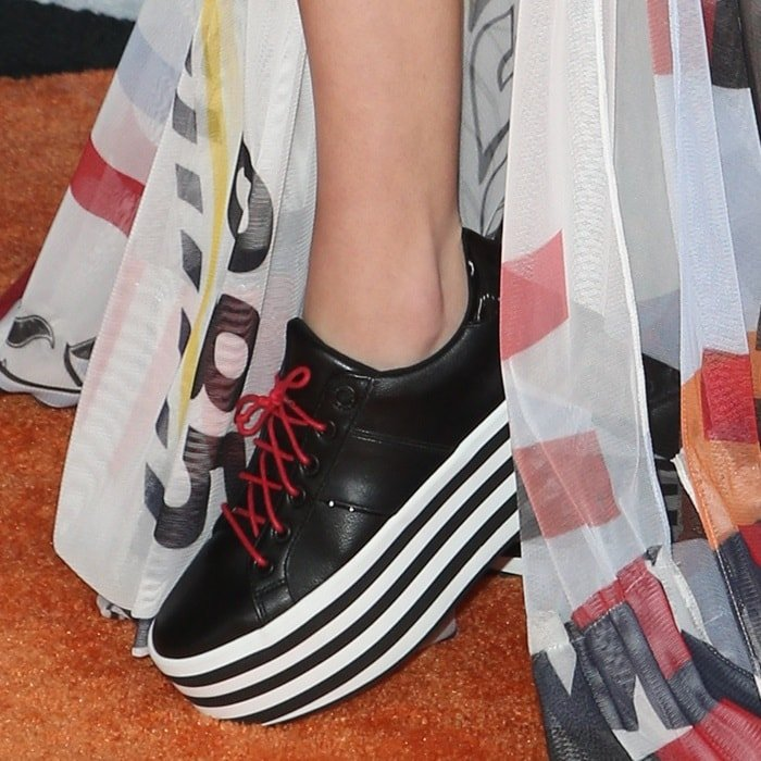 Jenna Ortega's black Aldo 'Nydoilia' platform sneakers with red laces