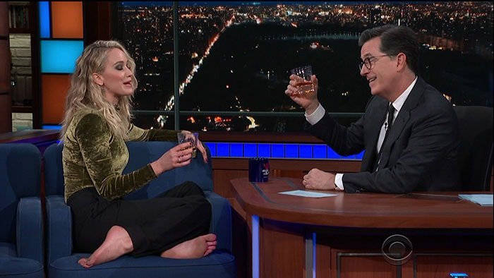 Jennifer Lawrence getting drunk and kicking off her Charlotte Olympia 'Gilda' sandals.