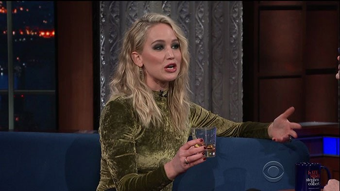 "Jennifer Lawrence having a drink of rum on ""The Late Show with Stephen Colbert."""