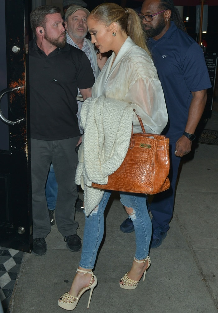 Jennifer Lopez wearingripped figure-hugging blue jeans