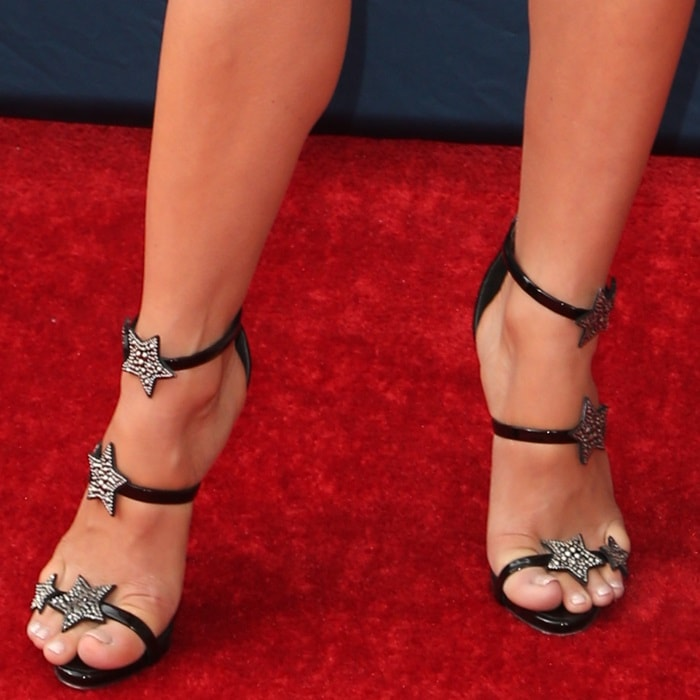 Julianne Hough's sexy feet in black patent Harmony Star sandals