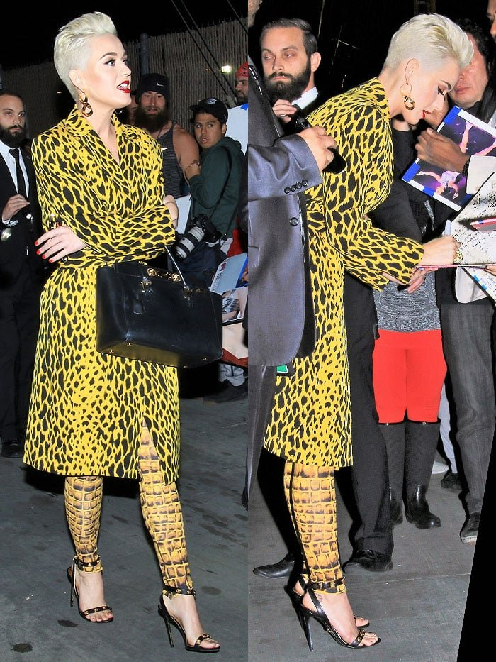 Katy Perry signing autographs in a yellow, animal-print outfit and Versace medallion ankle-strap sandals.
