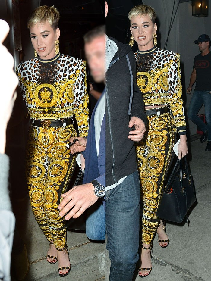 Katy Perry wearing a Versace yellow animal-print ensemble with Versace ankle-strap sandals at Craig's Restaurant.