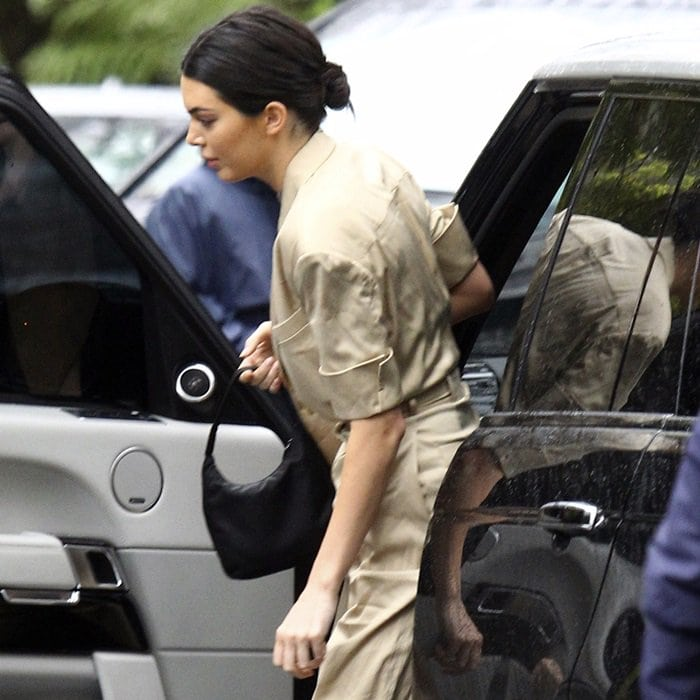 Kendall Jenner carrying a Prada bag while exiting her car