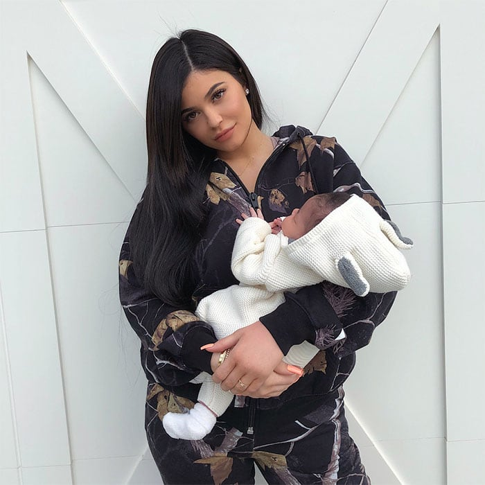 Kylie Jenner's Instagram post of her cradling her one-month-old baby daughter Stormi.