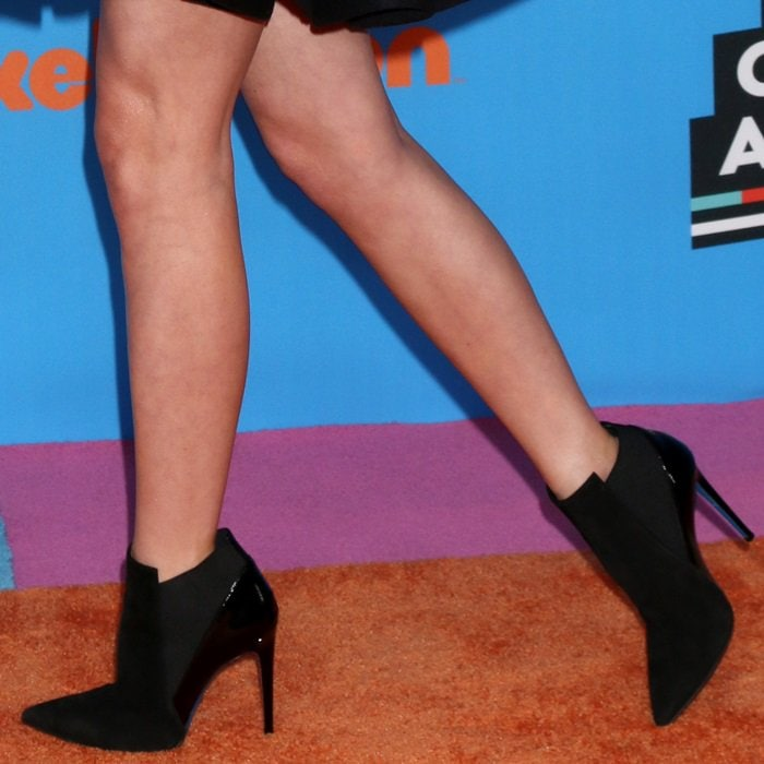 Lizzy Greene's pins in edgy black suede and patent pointed ankle boots from Loriblu