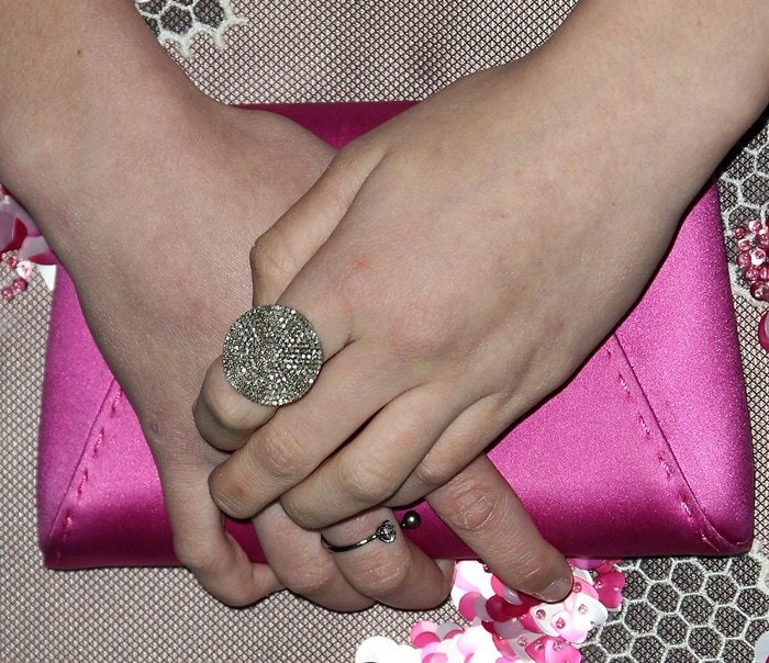 Lizzy Greene showing off her glittering rings