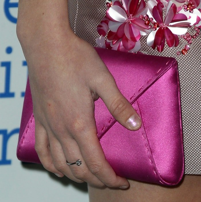 Lizzy Greene toting a pink clutch