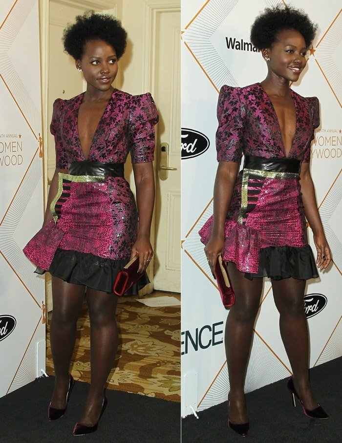 Lupita Nyong'o wearing a black and purple Ronald van der Kemp Fall 2017 Couture dress