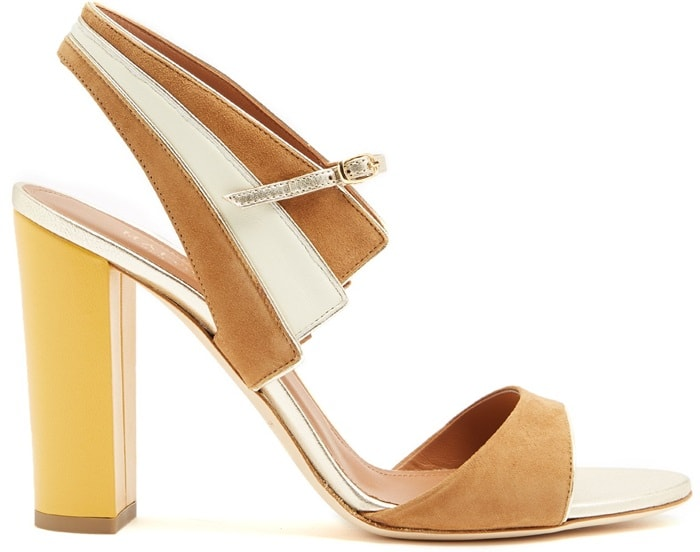 The yellow leather-covered block heel of Malone Souliers' tan-brown sandals gives them a spring-ready slant