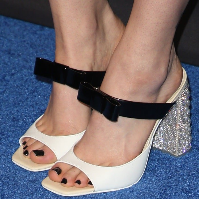 Madeline Brewer's pedicured feet in two-tone mules in calf and patent leather