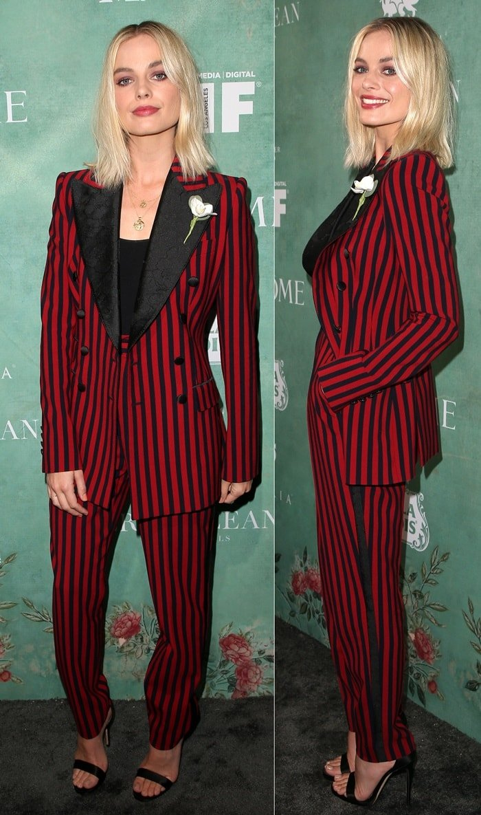 Margot Robbie wearing an androgynous black & red stripe two-piece suit by Dolce & Gabbana