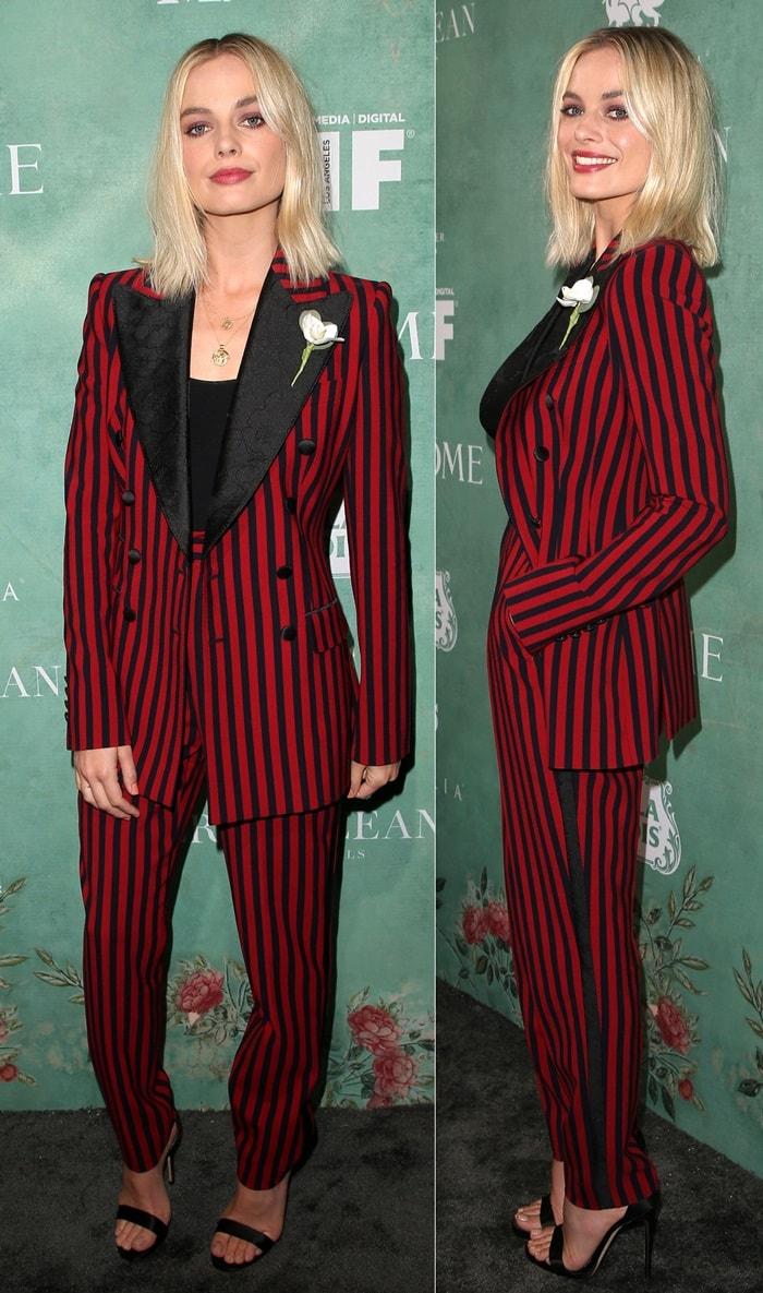 Margot Robbie wearingan androgynousblack & red stripe two-piece suit by Dolce & Gabbana
