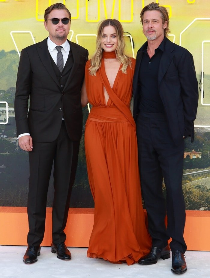 Leonardo DiCaprio, Margot Robbie, and Brad Pitt pose together while hitting the red carpet at the UK premiere of their hit film Once Upon a Time in Hollywood