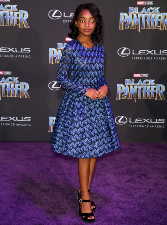 Marsai Martin wearing a blue bonded lace long sleeve dress from Maje