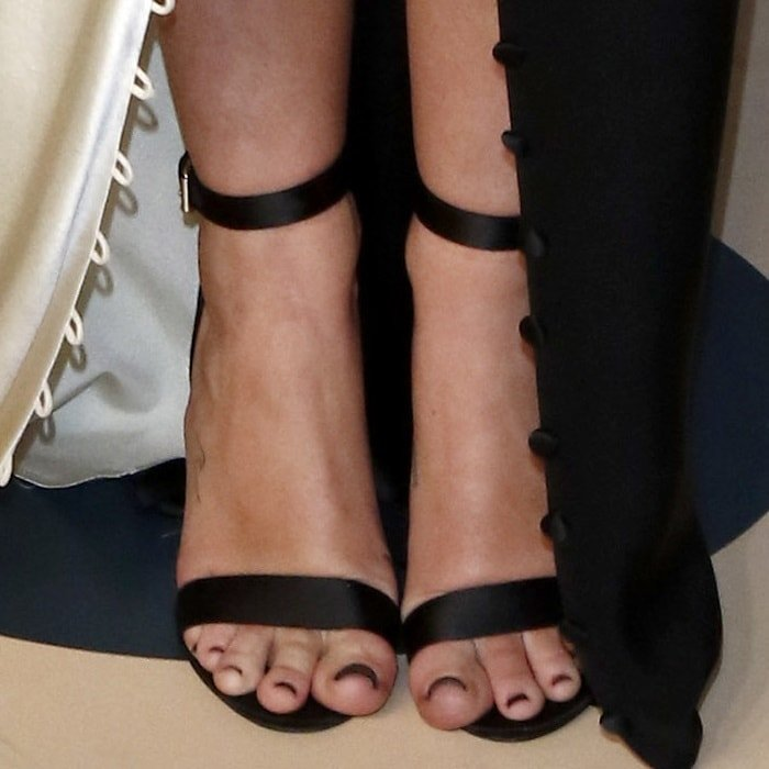 Miley Cyrus's feet in black ankle-strap sandals
