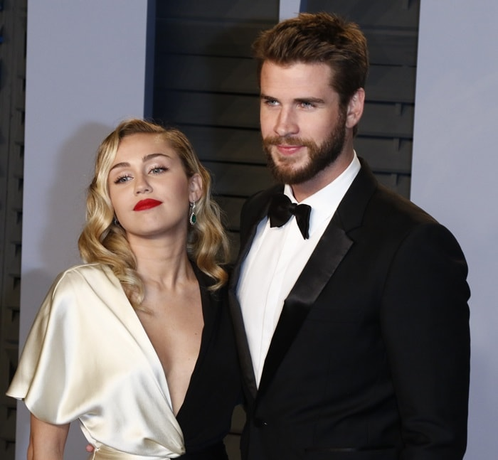 Miley Cyrus and her fiancé Liam Hemsworth at the 2018 Vanity Fair Oscar Party