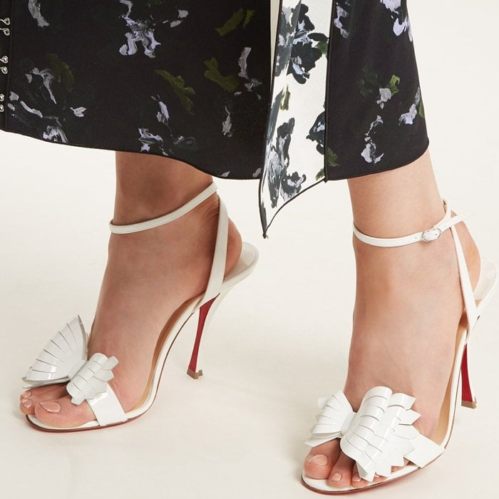 Christian Louboutin's white patent-leather Miss Valois sandals are a timeless finisher to evening edits