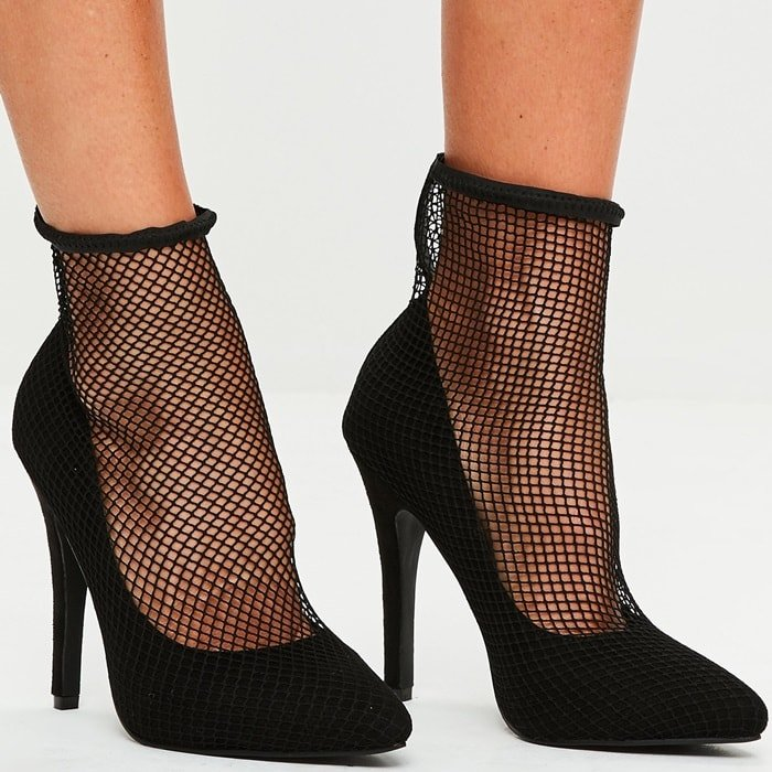 Pumps featuring a jet black hue, pointed details to the front and a fishnet style