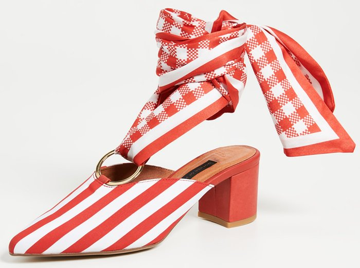 The red and white striped cotton 'Amber' mules have a red check ankle tie in silk looped around a central gold metal ring