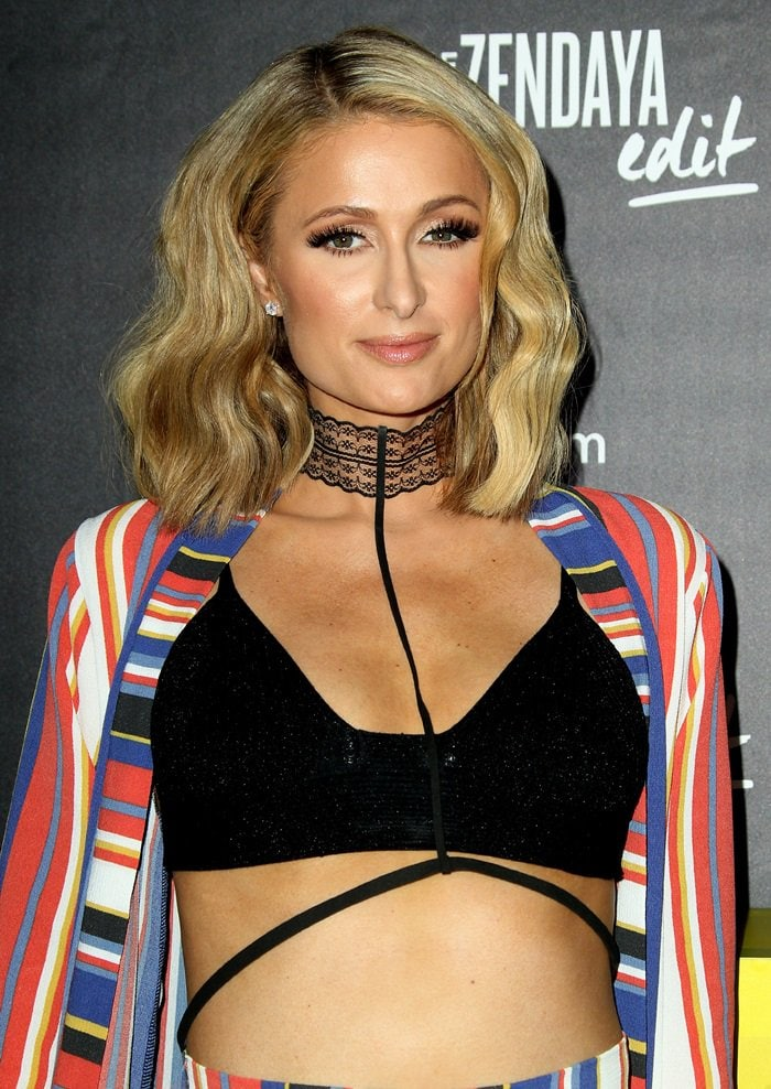 Paris Hilton showed off her envy-inducing toned torso in a black crop top