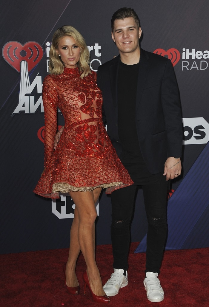 Paris Hilton posing with her 32-year-old fiancé, Chris Zylka, looked handsome in a navy suit