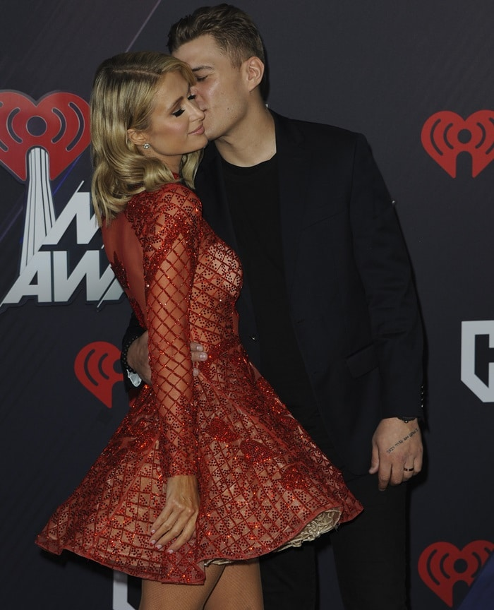 Paris Hilton and Chris Zylka coupled up on the red carpet