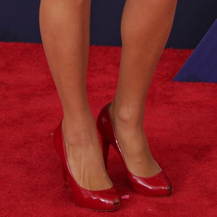 Paris Hilton's feet in Christian Louboutin 'Open Clic' pumps