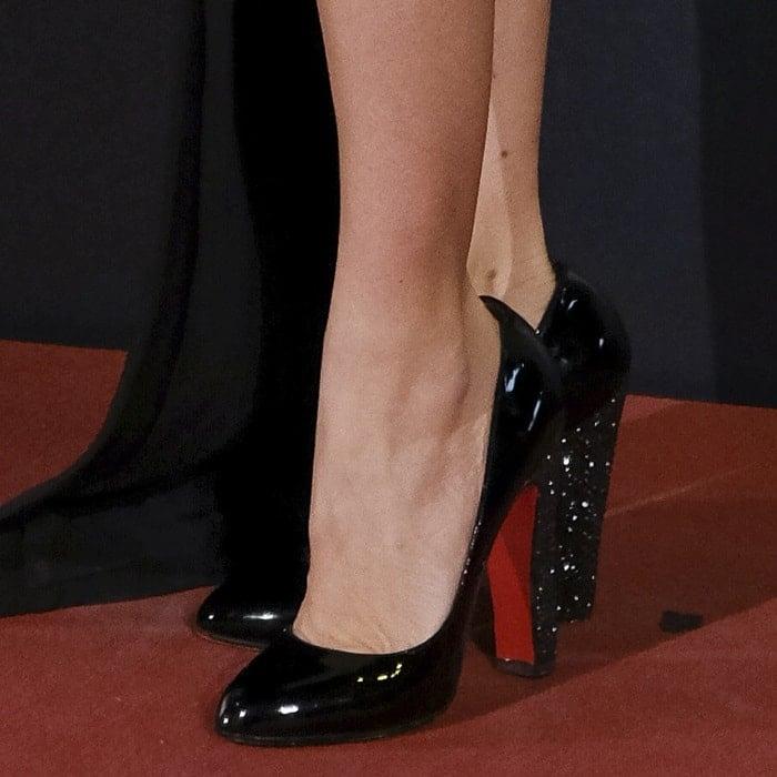 Penelope Cruz's feet in Christian Louboutin 'Clichy' strass almond toe pumps