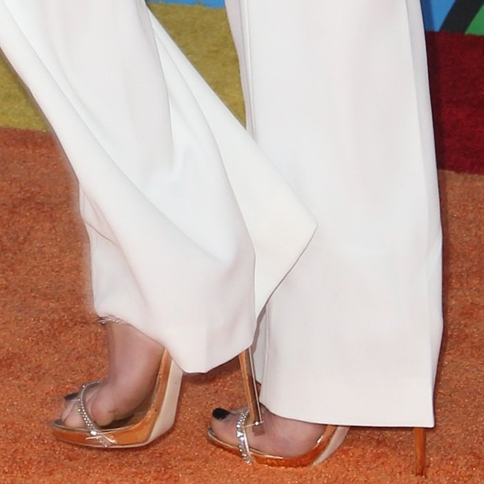 Peyton List's feet in Giuseppe Zanotti's popular 'Harmony Sparkle' crystal-embellished sandals
