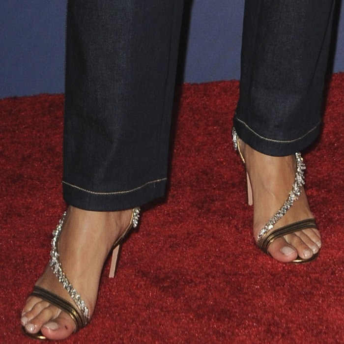 Rita Ora's feet in crystal-embellished metallic leather sandals by Aquazzura