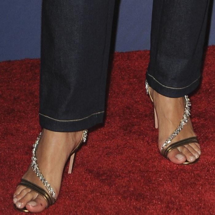 Rita Ora's feet in crystal-embellished metallic leather sandals by Aquazzura