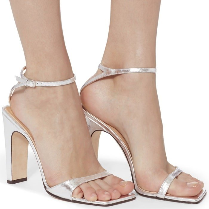 These sandals are rendered in a silver laminated leather with a modern square finish open toe