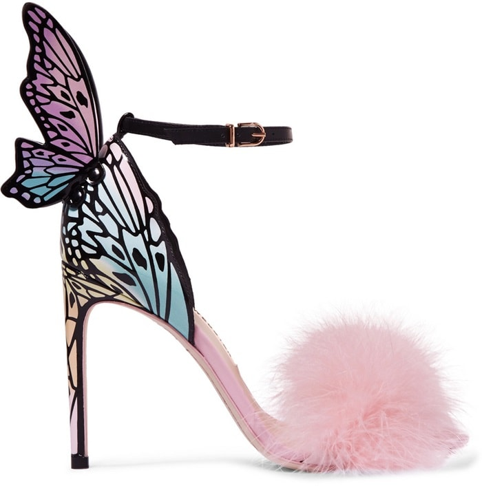 Playful and flamboyant as ever, they are designed in two parts: an open toe with feathered strap, and patent leather heel that features a laser-cut butterfly trim and multi-coloured tint