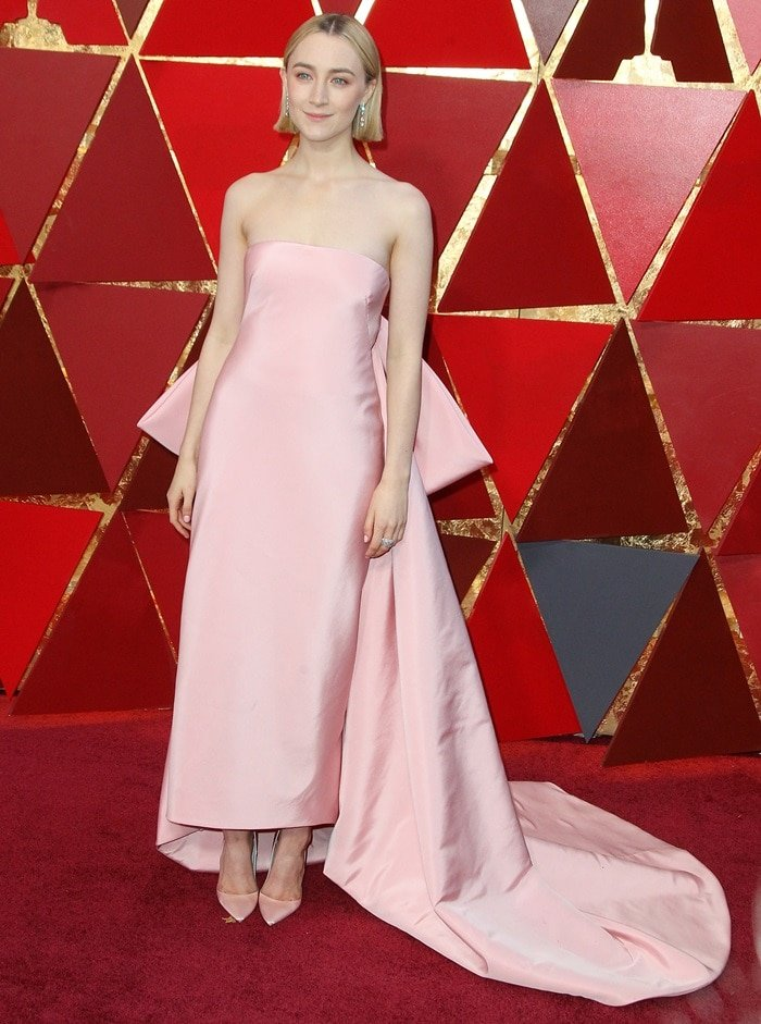 Saoirse Ronan inalovely pink Calvin Klein by Appointment gown featuring a voluminous bow and long train