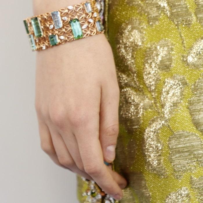 Saoirse Ronan wearinga bracelet in 18-carat rose gold
