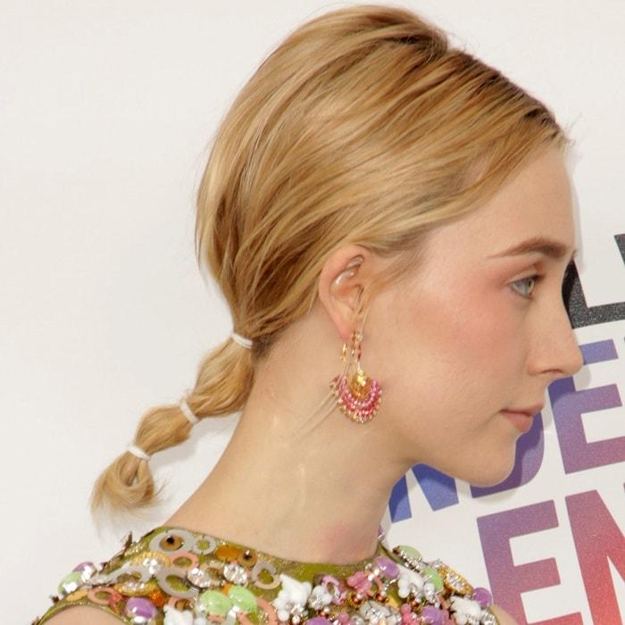 Saoirse Ronan wearingPiaget 'Sunny Side of Life' High Jewelry earrings