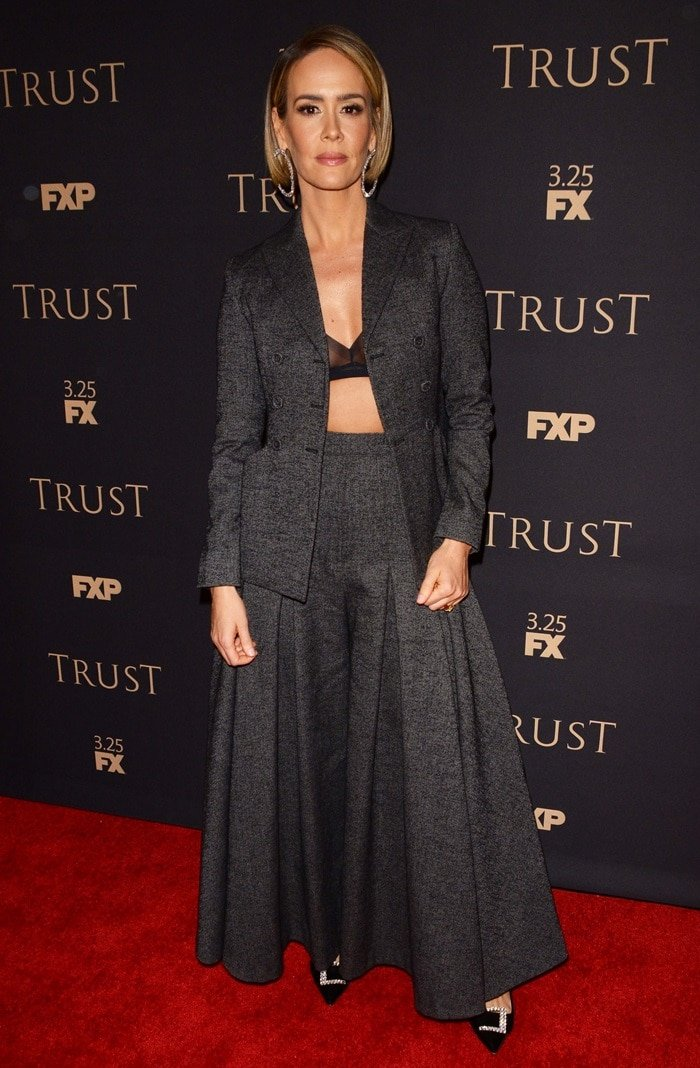 Sarah Paulson flashed cleavage in a black Hanro of Switzerland bra and accessorized with oversized Fallon earrings