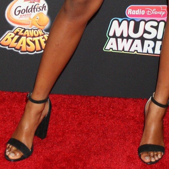 Skai Jackson showing off her feet and legs in Carrson heels from Steve Madden