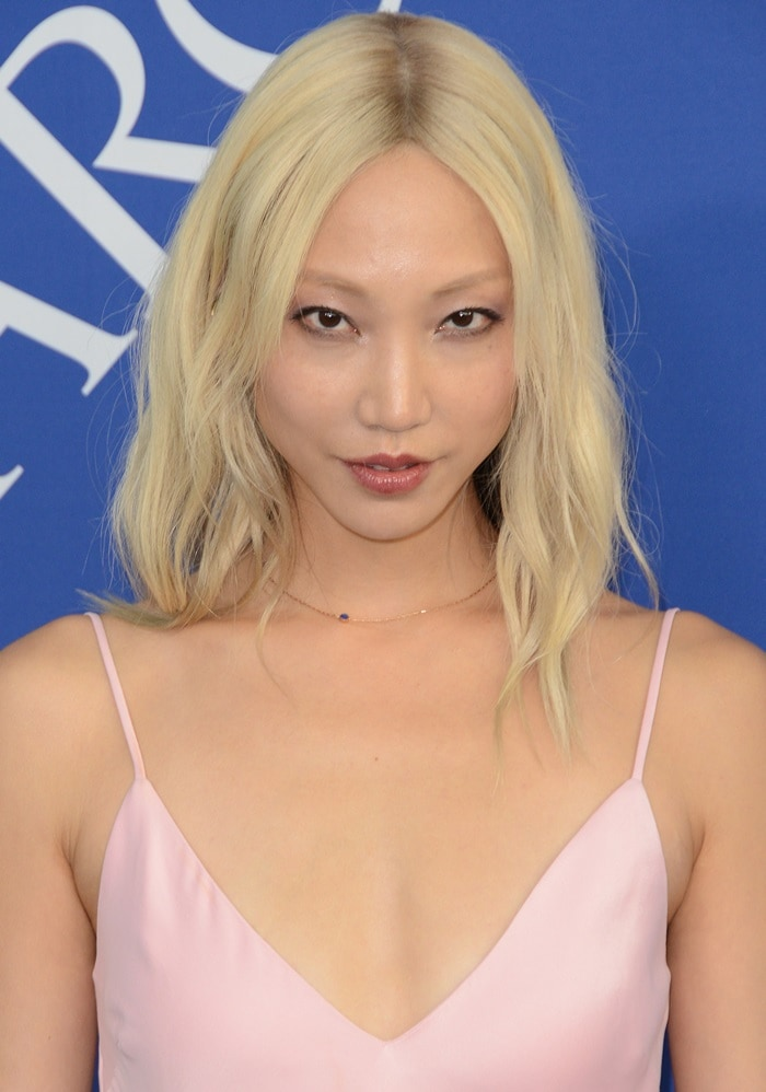 Soo Joo Park in a pink Frame dress at the 2018 CFDA Fashion Awards held at the Brooklyn Museum in New York City on June 4, 2018