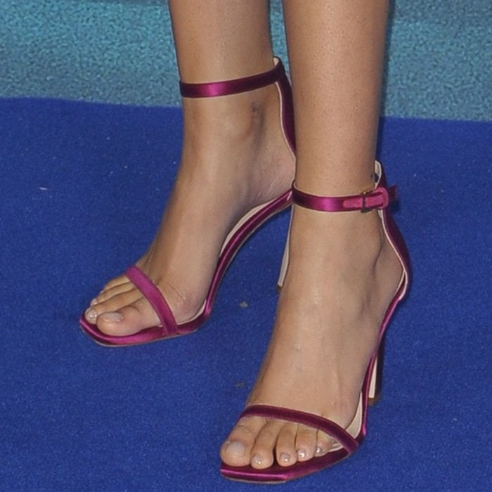 Storm Reid's feet in raspberry ankle-strap sandals