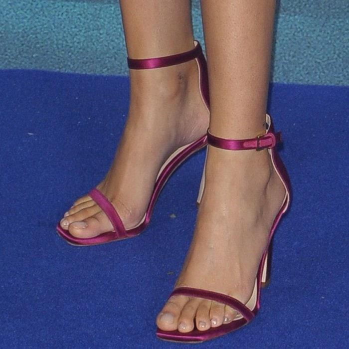 Storm Reid's feet inraspberry ankle-strap sandals