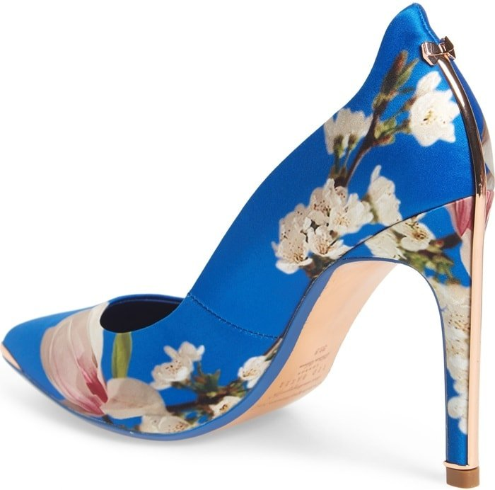 An eye-catching print adds sophisticated character to this lofty, pointy-toe pump