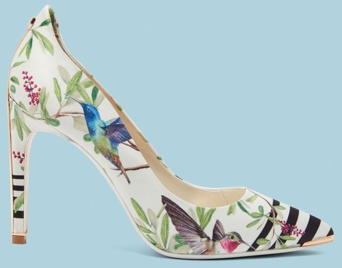 Set to a high stiletto heel and sloping into a sleek pointed toe, it is decorated with floral and stripe detail for a stand out effect